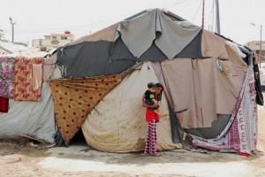 Una familia que vive en un campamento en Baghdad, Iraq, explicó que las tiendas de campaña no estaban preparadas para el invierno. Crédito: WFP/Mohammed Al Bahbahani.