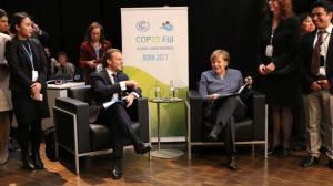 El presidente francés Emmanuel Macron y la canciller alemana Angela Merkel en un plenario de alto nivel en la COP23, realizada en Bonn del 6 al 17 de noviembre de 2017. Crédito: Arial Alexovich/DPI.
