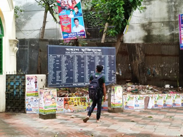 A student walks by a board displaying names of freedom fighters. The New Digital Security Act 2018 makes speaking against any freedom fighter leader a punishable offence. Credit: Stella Paul/IPS