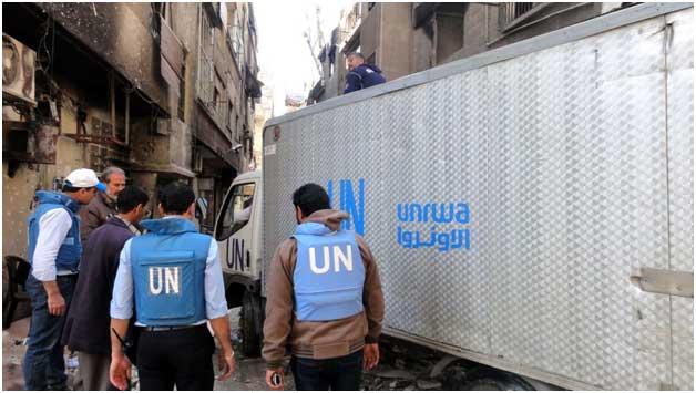 Un camión con ayuda para los refugiados palestinos, de Agencia de las Naciones Unidas para los Refugiados de Palestina en Medio Oriente. Crédito: UNRWA